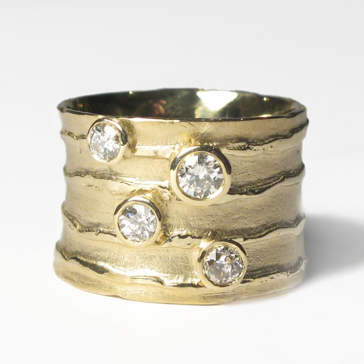 18ct yellow gold etched strata ring using customers own gold and set with customers own brilliant cut diamonds.