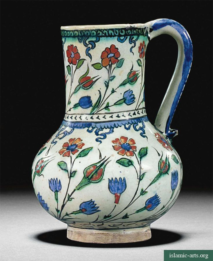 AN IZNIK POLYCHROME POTTERY JUG, TURKEY, CIRCA 1575