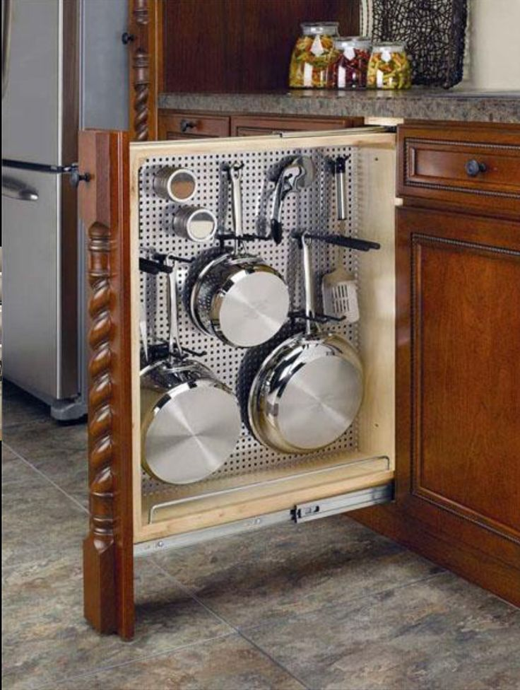 kitchen peg board pot & pan storage from normally wasted space