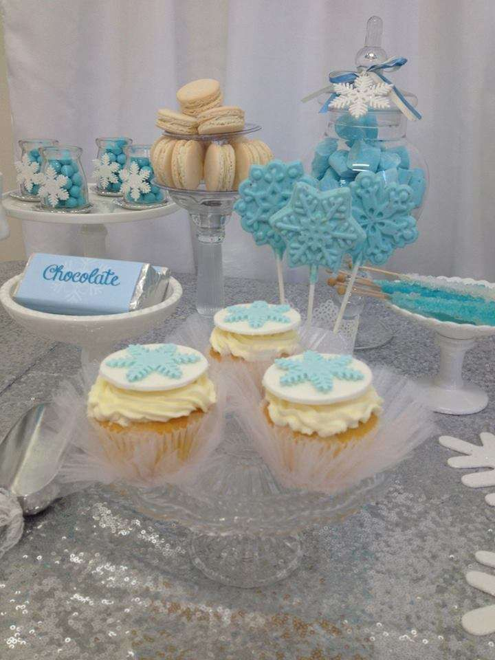 Cupcakes and macarons at a Frozen birthday party! See more party planning ideas at CatchMyParty.com!