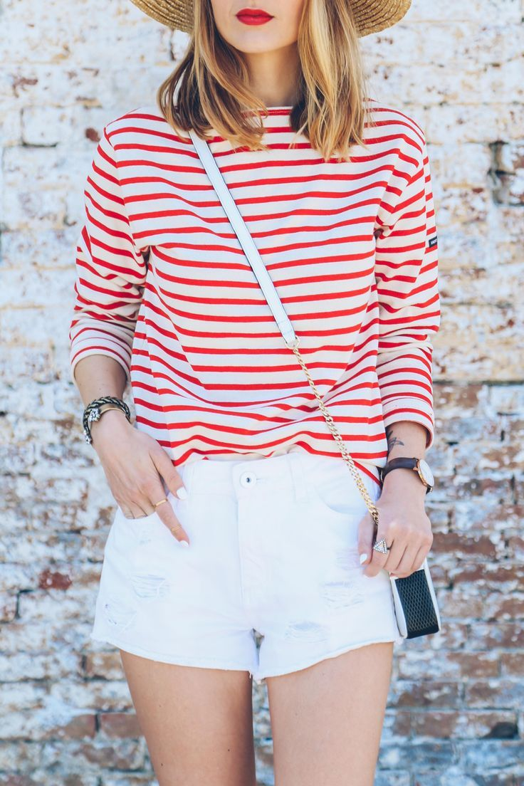Red striped shirt, red lipstick, white jean shorts and summer hat.