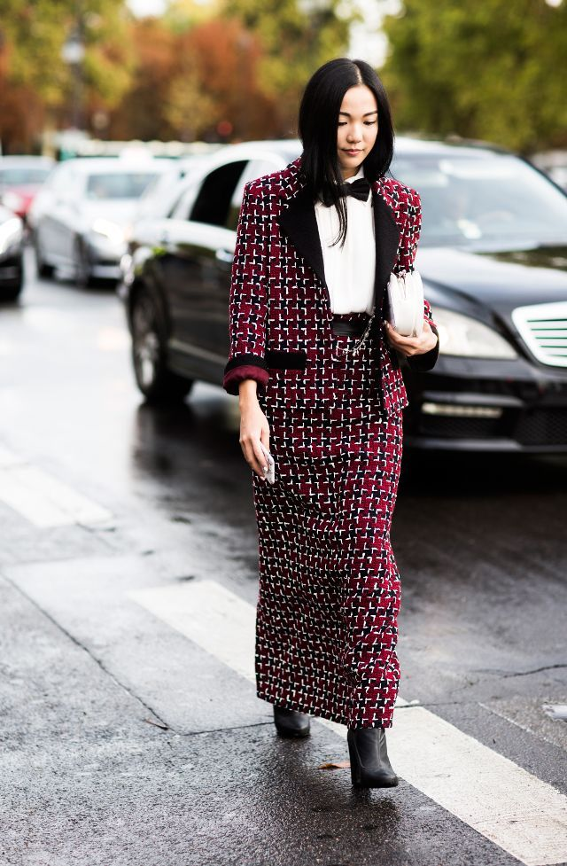 Swap your trousers for a floor-length skirtin your next suited ensemble.