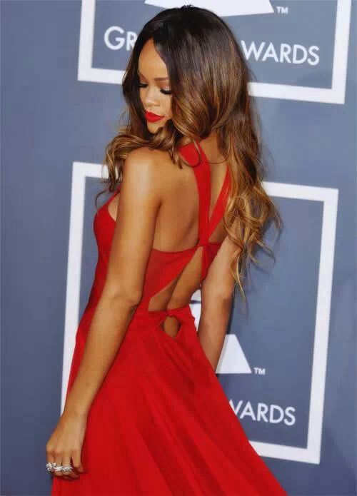 Rihanna in a stunning red back detailed dress