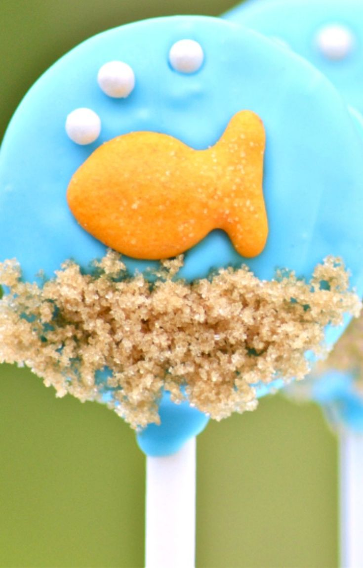 Gone Fishing Oreo Pops How-To ~ These adorable Goldfish Oreo Pops are as tasty as they are cute!  A little salty, a little sweet.  Fun for a Nemo party!