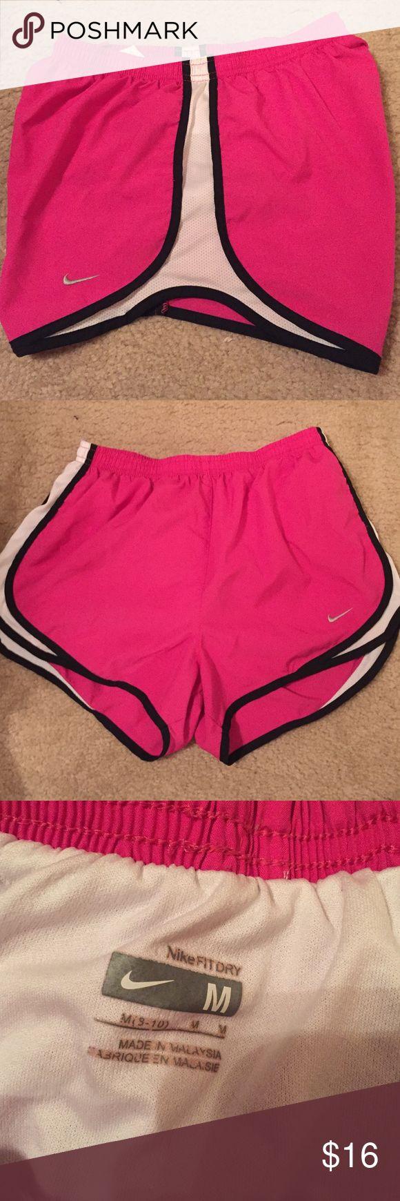Nike women's running shorts size medium Nike women's running shorts size medium. Hot pink with black and white detail. Good condition! Nike Shorts