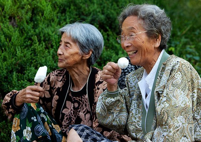 North Korean Friends enjoying Ice Cream - Photo by Constantine James.