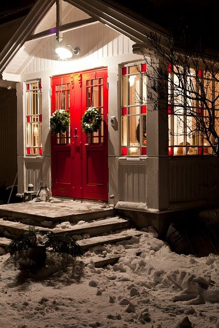 Tiny house in winter ... love the red glass on the windows