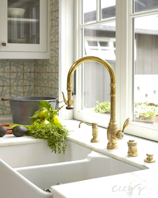 Beautiful Cottage Kitchen With A White Dual Apron Sink Paired With A Gold Gooseneck  Faucet