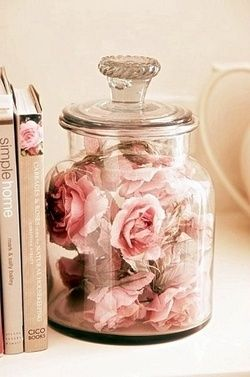 Dried roses in a jar. I do this. I have one rose dried and saved for every bouquet Tim has brought me in a huge glass orb shaped vase. Theres a good 20 in there of all colors. If I could figure out how to dry other flowers from other bouquets it would have overflowed by now.