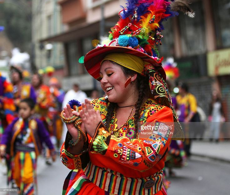 """A woman of an Andean community performs on the street during 'Inti Raymi"""" (in English: Sun's Party) celebration on June 21, 2015 in Valparaiso, Chile. Inti Raymi is the Andean people celebration of their New Year that matches with the winter solstice. Andeans commemorate New Year with typical dances on the street."""