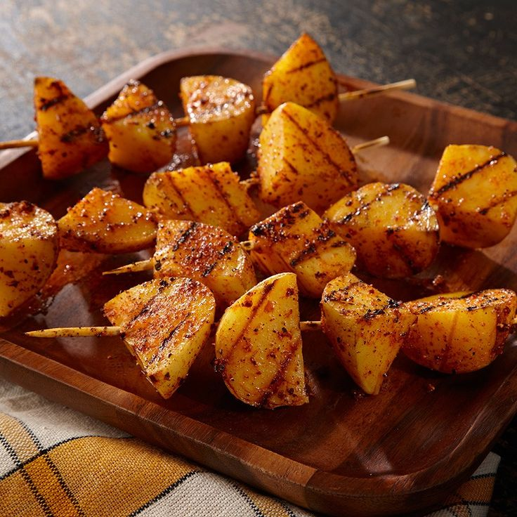 To ensure that potatoes are cooked on the inside before they are fully grilled on the outside, first partially cook them in the microwave. You need to only grill them until they are crisp and golden brown