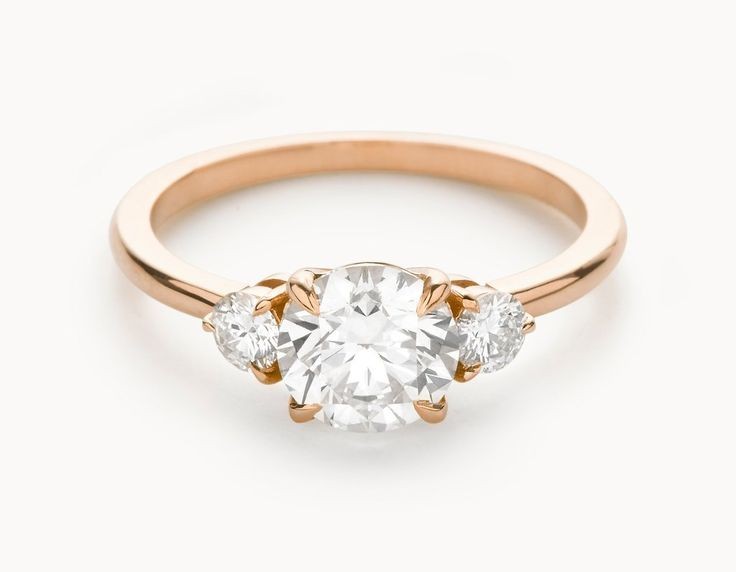 Minimal 18k Rose Gold Three Stone Diamond Engagement Ring. My preference is the gold.