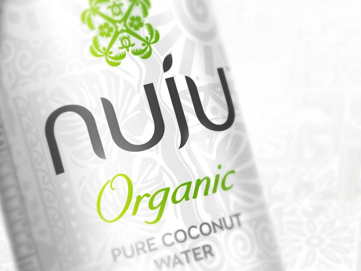 When type is in harmony with the rest of the visual elements... Nuju organic pure coconut water packaging by Curious Design