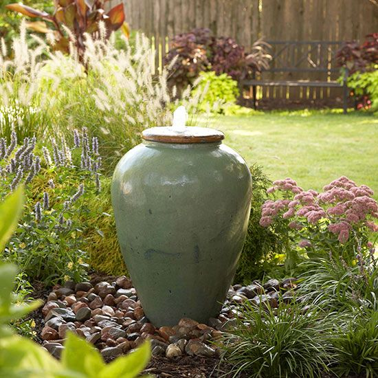 Spruce up your yard and enjoy the soothing, tranquil sounds of water with this DIY urn fountain. We'll show you exactly how to make this beautiful fountain that will add interest to your yard. #gardenfountain #outdoorfountain #diy