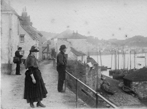 From a picturesque fishing village to an internationally famous artists' colony, discover Newlyn and its people through some rare photographs