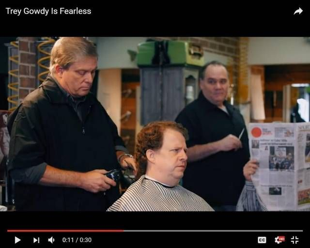 A scene from a new political ad by South Carolina Congressman Trey Gowdy (behind newspaper) which pokes fun at his hair.