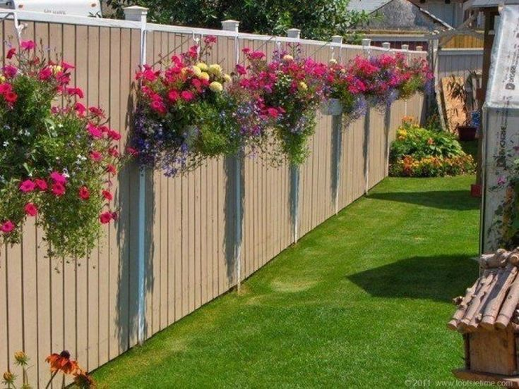 fence with flowers in baskets