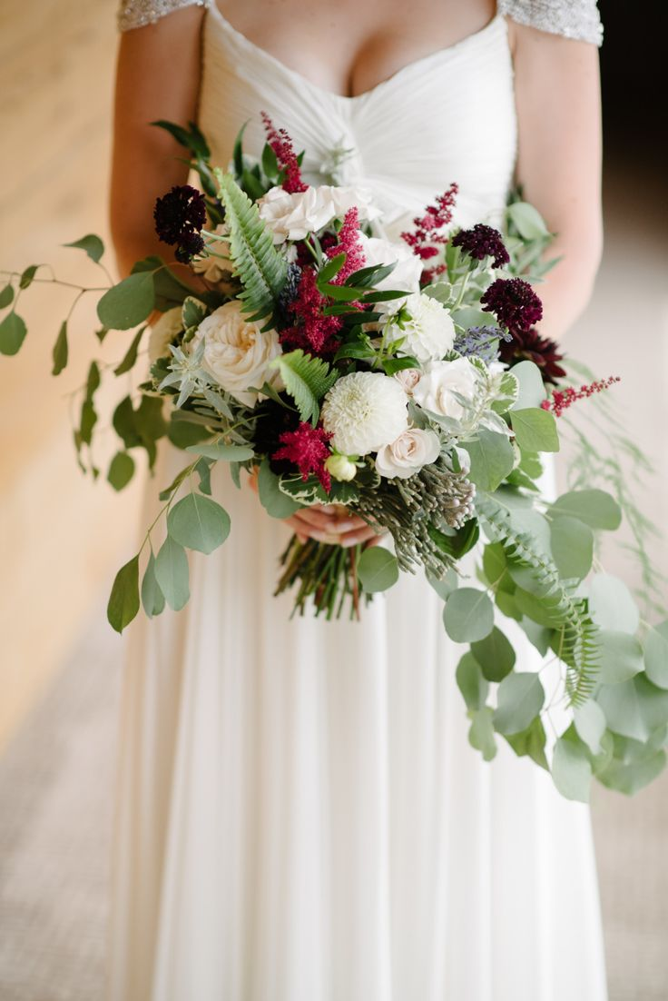 Rustic rose, astilbe and eucalyptus wedding bouquet: Photography : Brian Hatton Photography Read More on SMP: http://www.stylemepretty.com/new-york-weddings/hudson-valley/2017/01/19/mixing-romance-and-greenery-with-a-stunning-rustic-backdrop/