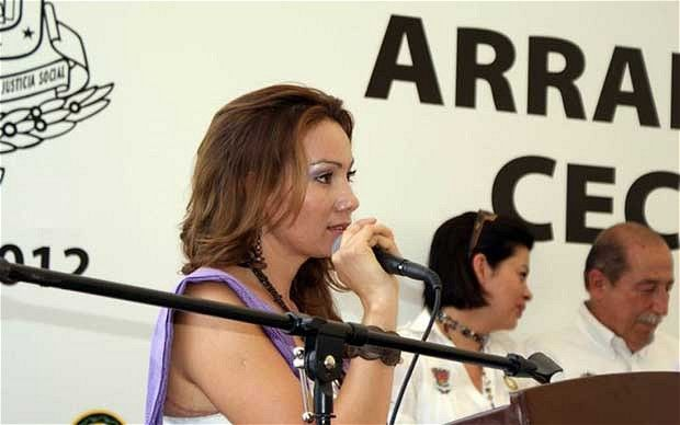 Maria Santos Gorrostieta: Mexico's mayor-heroine found beaten to death - A mayor who became a heroine in Mexico after defiantly standing up to the country's brutal drug lords has been found beaten to death after sacrificing herself to save her young daughter.
