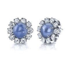 14 Karat White Gold Blue Star Sapphire & Diamond Cluster Earrings; Set with 2-Star Sapphires  = 12.00 Carats, and 20 round Diamonds to total approximately 4.20 carats
