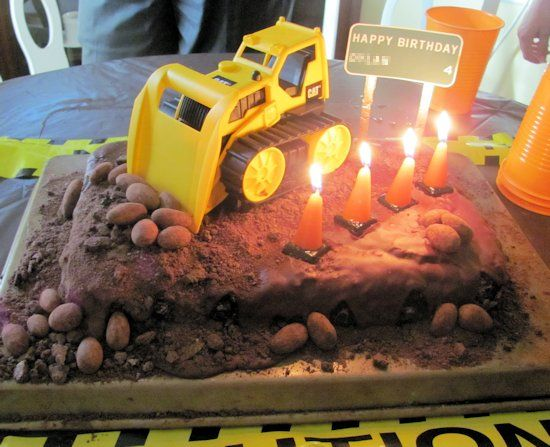 Road construction birthday cake with traffic cone candles