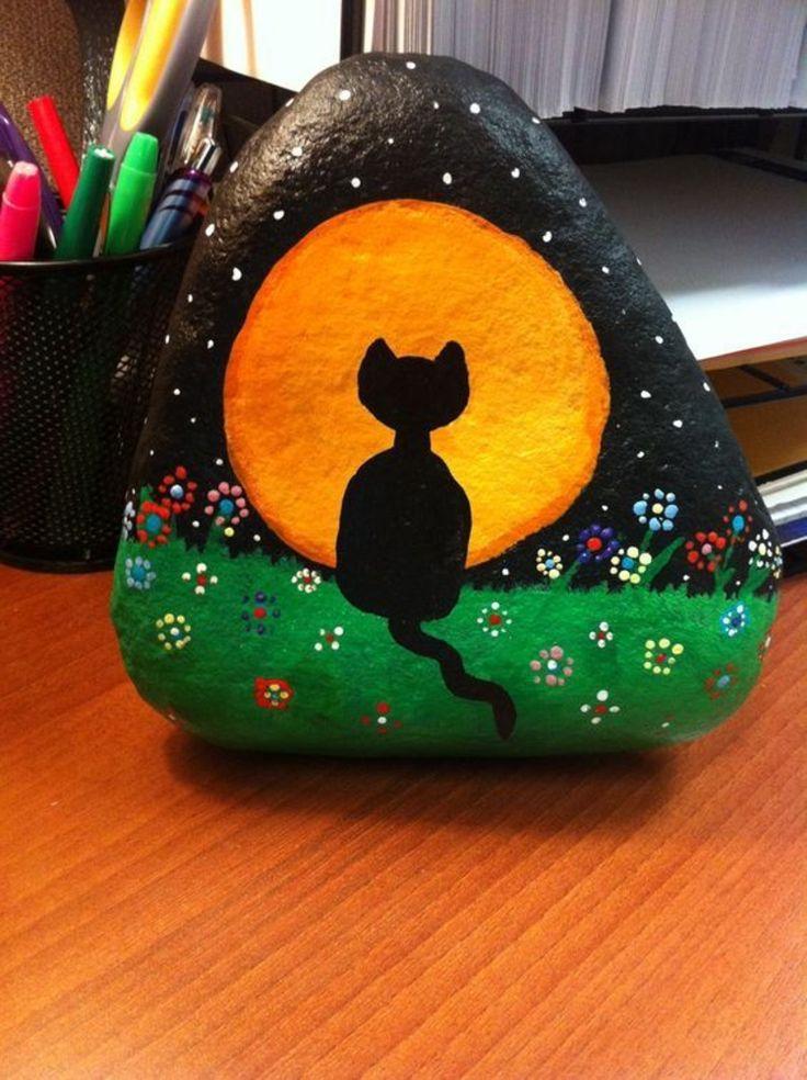 Steine bemalen schwarze Katze