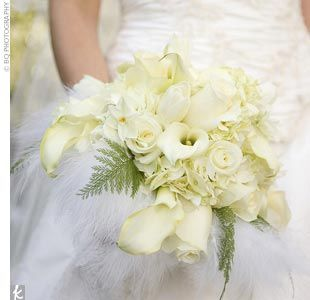 all-ivory bouquet of hydrangea, French tulips, garden roses, narcissus, mini calla lilies, and ferns,  hand-tied with a collar of white ostrich feathers.