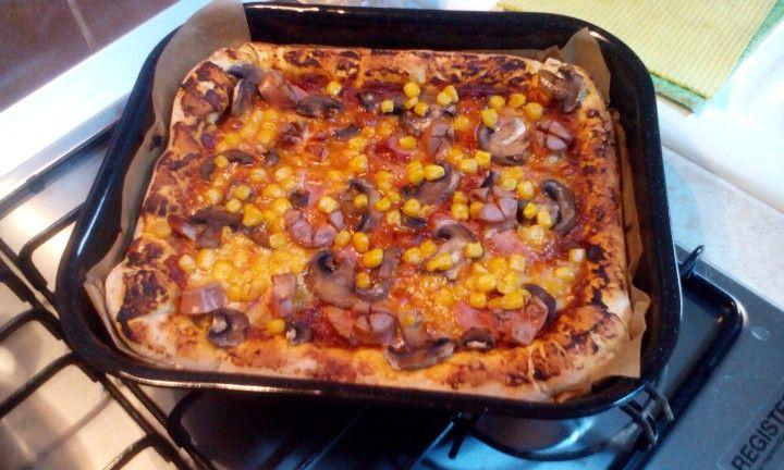 Home made Pizza with mozzarella, prosciuto, mushrooms and corn . yuuumy