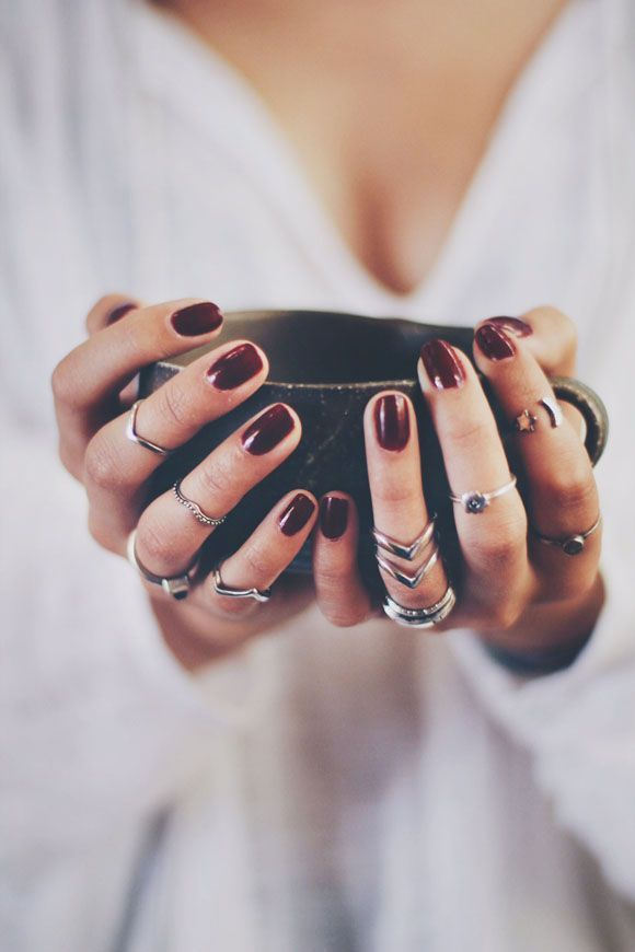 Dark red nails and stacked rings are perfect for the fall! Shop fall nail colors at Walgreens.com.