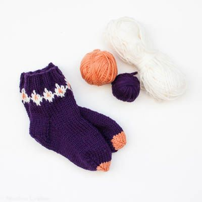 A sock knitting pattern, to make color-work socks. The socks are knitted…