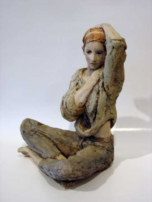 """Terra cotta sculpture """"Seated Girl in Jeans and Loose Sweater"""" by Rodney Shaw"""