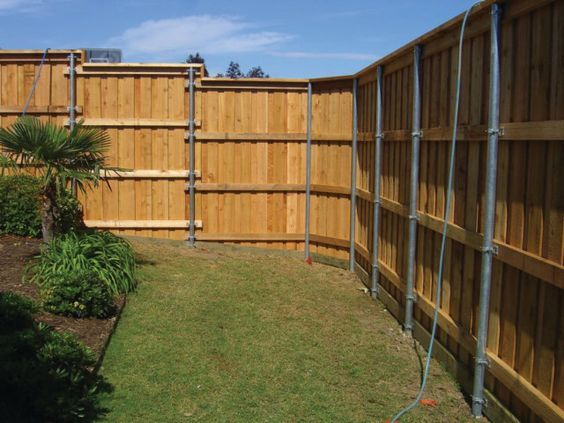 The Fence Line: Building a Wood Fence with Metal Posts? See next picture to see how to build a facade around the posts