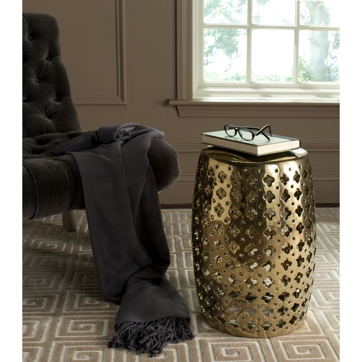 Incredibly versatile, the Lacey indoor-outdoor garden stool in plated gold adds a feminine touch to transitional spaces as a seat or side table.