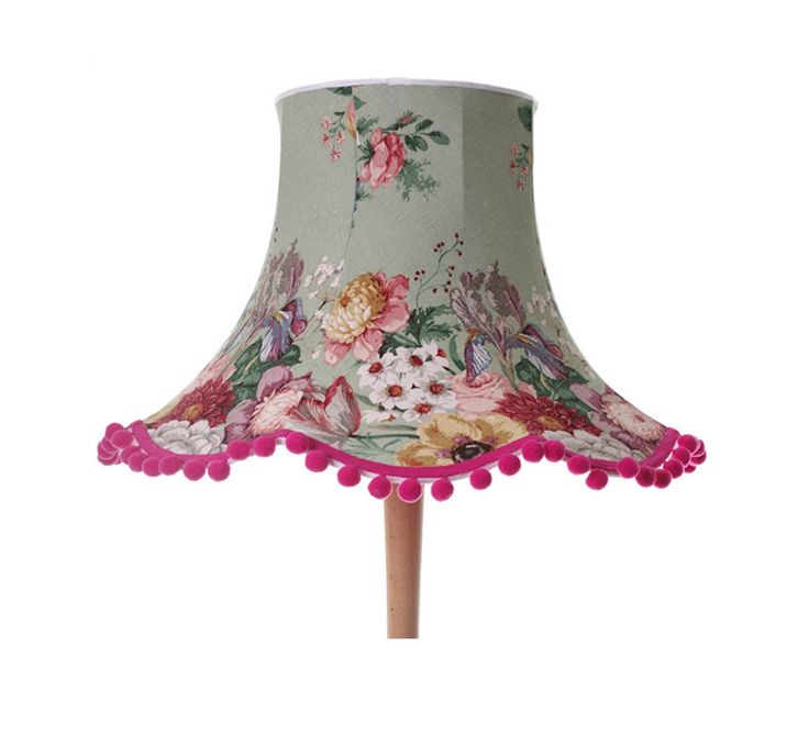 Large handmade lampshade on a vintage frame in vintage floral green fabric with white red