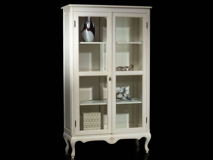 Beautiful classic vitrine modified into a simple and plain top bookcases