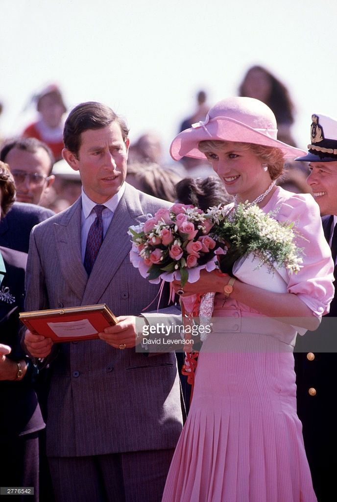 "Charles:  ""Diana!! I think one of those bouquets is for me. After all I am the Prince of Wales and future king. I'll trade you this booklet for it."" Diana: 'Nope."""