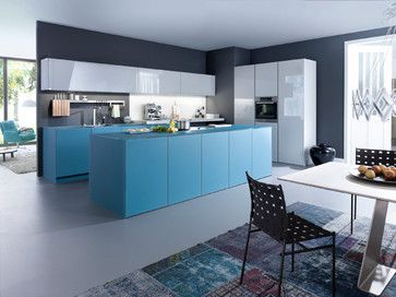 """Matt glass and glossy lacquer, muted blue-green and light grey, this modern and young colour- and material-combination brings a fresh and refreshing mood into the room. The new retro-design colour """"petrol"""" is used in the LEICHT kitchen """"Largo-FS   Ios-M""""on large fronts and side panels of the wall- fixed floor units of the isle and for the worktop."""