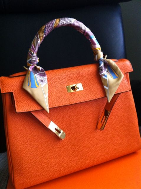 Orange Hermes Kelly with Twilly.   Love the scarf wrapped handle