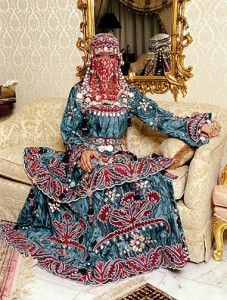 Don't know if such wedding dresses are still worn in Saudi Arabia. As far as I remember, white gowns still remain extremely popular.
