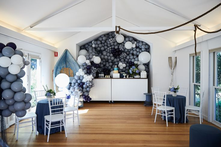 LETTUCE & CO - STYLE. EAT. PLAY - row, row, row, your boat...  nautical themed 1st birthday. overall styled room view. balloon masse spilling from an actual life-sized rowboat. hanging marine rope, oars & nets.