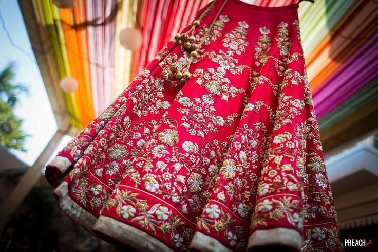 Red lehenga with heavily golden embroidery is in every bride's dream list.  #TrendingBridalWear, #BridalWearInspirations, #LehengaInspirations, #TrendingLehengas, #BridalLehengas, #BridalWear, #RedLehengas