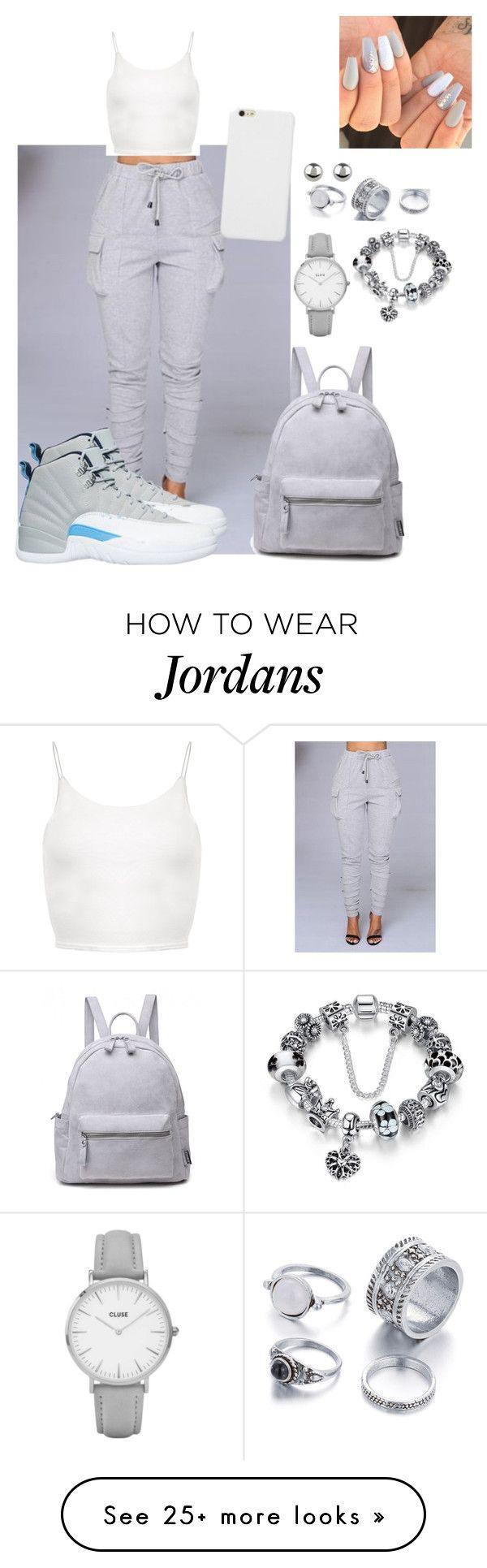 El pantalón gris camisa blanca Jordán rojas o blancas