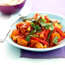 Filling and Healthy Vegetable Curry: courgette = zucchini, coriander = cilantro; optional topping: use FF plain yogurt, chopped fresh mint; may add chickpeas, may serve with brown or wild rice