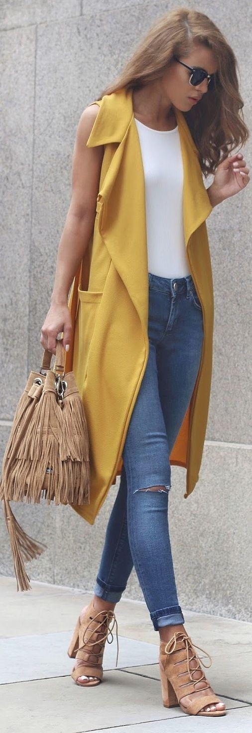 Mustard maxi vest + skinny jeans.