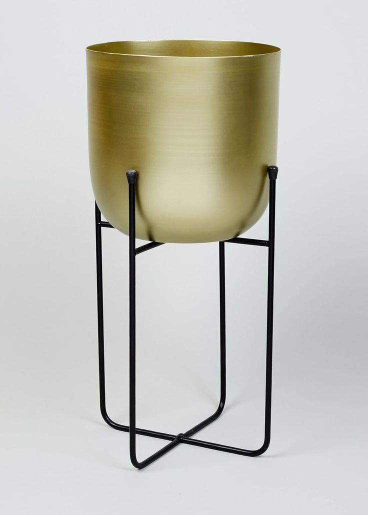 Enhance your home with chic metal details with our metallic gold planter presented on a