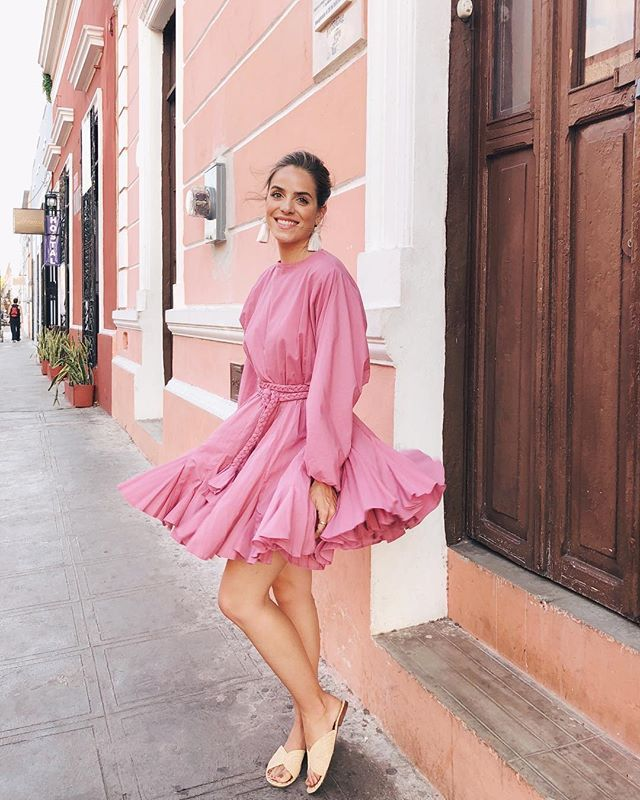 I have this @rhoderesort dress in a few different colors and its always one of my favorite pieces to travel with took this pink one out in Mérida #gmgtravels #mexico #merida #yucatan #rhoderesort #pink #meridayucatan #travelmexico