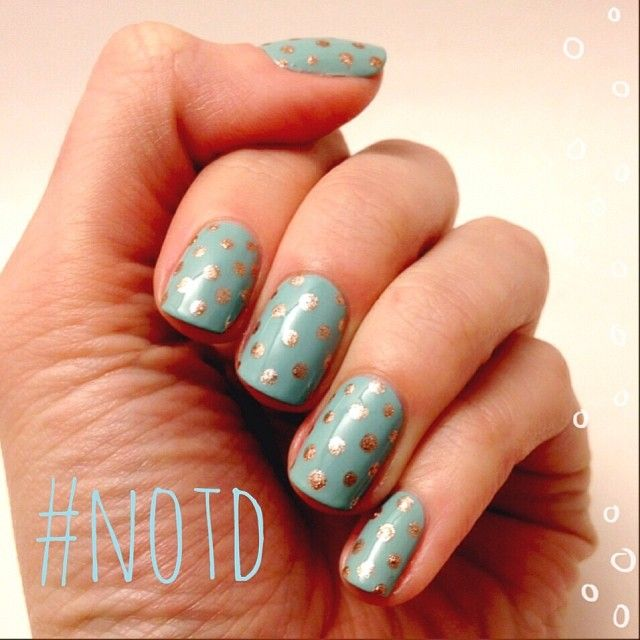 Robin's egg blue nails with gold dots