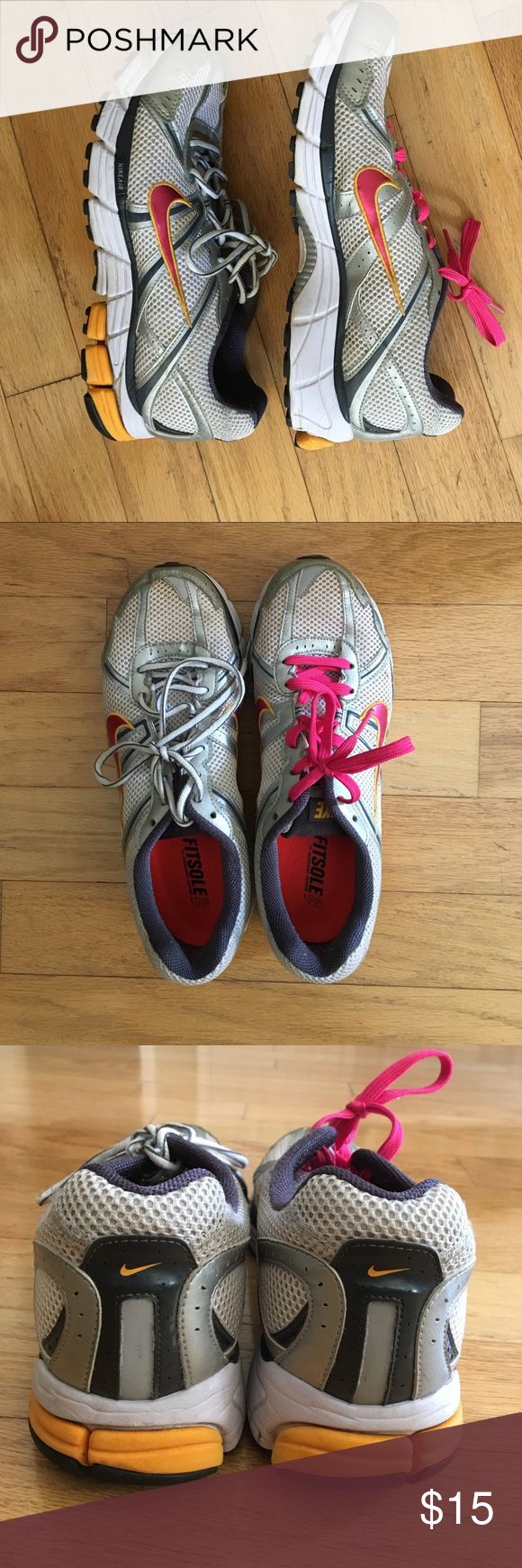 NIKE air Pegasus running shoes gently worn NIKE air Pegasus women's running shoes. One lace is pink for breast cancer. Nike Shoes Athletic Shoes