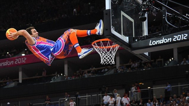 An exhibition dunker performs at the Basketball Arena