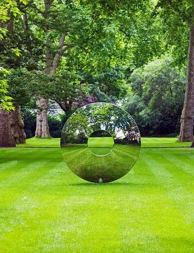 Lawn featuring contemporary sculpture by David Harper. Via Houzz.